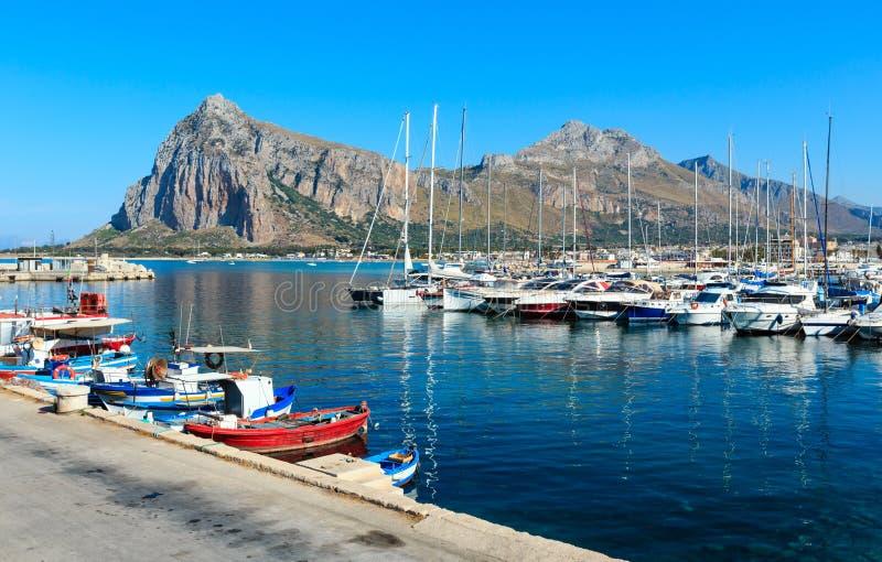 San Vito lo Capo port, Sicily, Italy. Boats in a port in San Vito Lo Capo and Monte Monaco in far, north-western Sicily, Italy stock photography