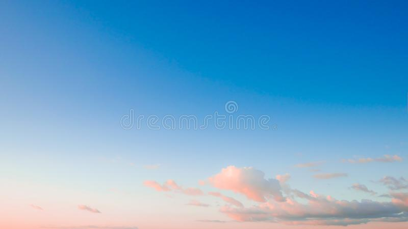 Bue sky and white cloud with warm sunlight before sunset. Winter blue sky and white cloud with warm sunlight before sunset stock images
