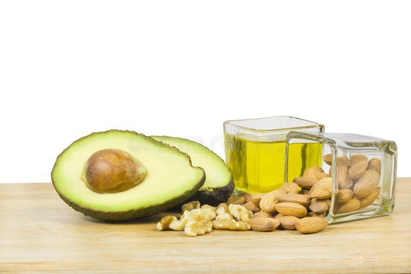Buena dieta de las grasas (aguacate, frutas secas y aceite) imágenes de archivo libres de regalías
