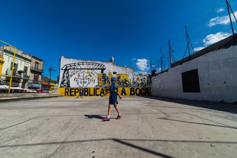 Soccer players in colorful La Boca district of Buenos Aires, Argentina. stock photos