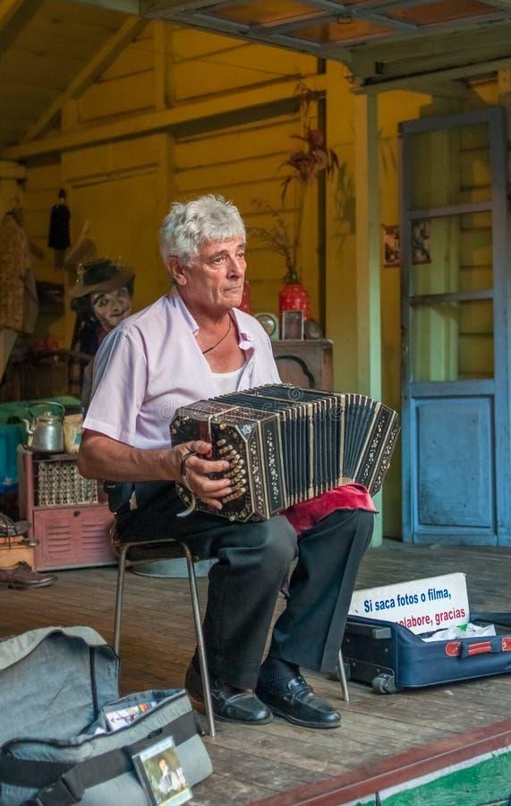 BUENOS AIRES, ARGENTINA - February, 24: La Boca bandoneonist, st. BUENOS AIRES, ARGENTINA - February, 24: La Boca sad bandoneonist, street musician on February stock photography