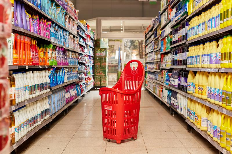 BUENOS AIRES / ARGENTINA - JULY 2019: Empty shopping cart in progress with full shelves in a supermarket stock photography