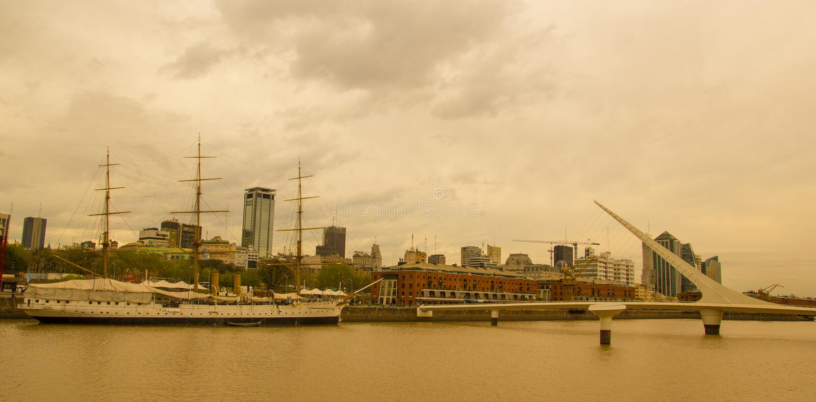 View of Puerto Madero, with the frigate Sarmiento and the Puente de la mujer. Puerto Madero, the old port of the city, now stock photography
