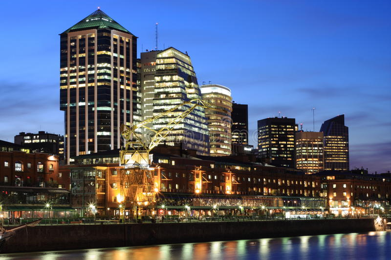 Buenos Aires cityscape. Modern office buildings at Buenos Aires city center. View from Puerto Madero harbor with waterside promenade in the foreground. Blue hour stock image