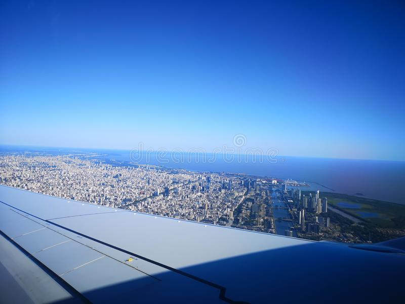 Buenos Aires cityview from the air. View of Buenos Aires city from an aireplane. View of the airplane wing and the River Plate. Puerto Madero quartier stock photography