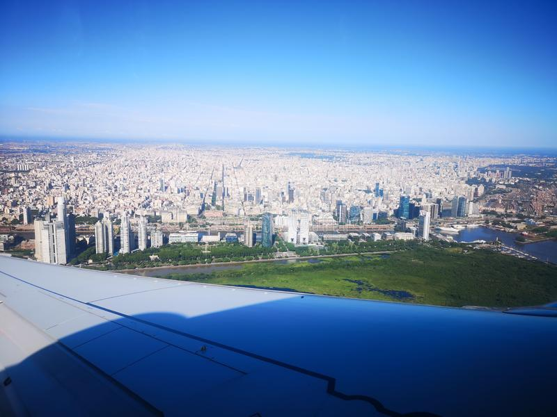 Buenos Aires cityview from the air. View of Buenos Aires city from an aireplane. View of the airplane wing and the River Plate. Puerto Madero quartier stock photo