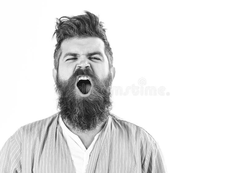 Buenos días Hombre con la cara soñolienta de bostezo en el fondo blanco imagenes de archivo