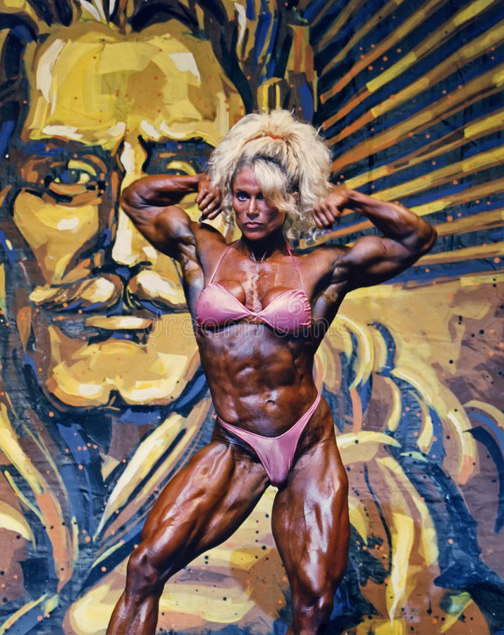 Buff Barbie Flex Appeal. Pro women's bodybuilder Melissa Coates, a Canadian, shows her flex appeal with a front double biceps pose at the IFBB Ms Olympia contest royalty free stock photos
