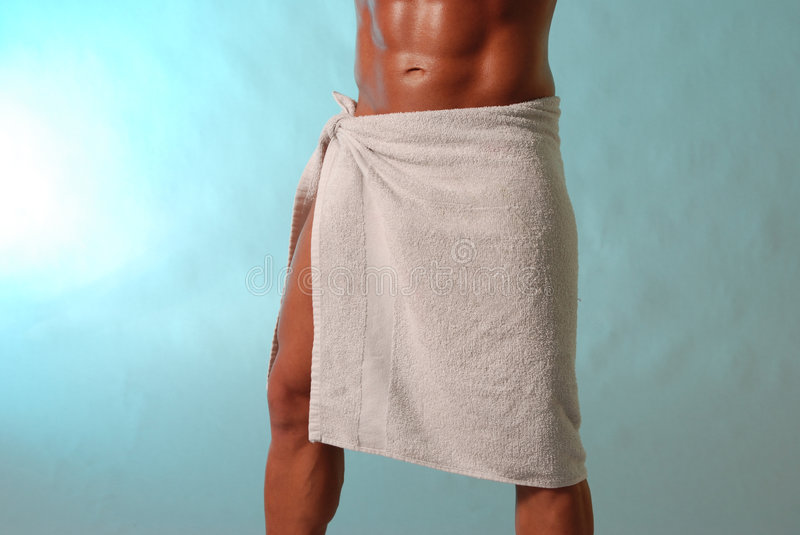 Buff guy with towel. Male torso and legs wearing a towel on aqua royalty free stock photos