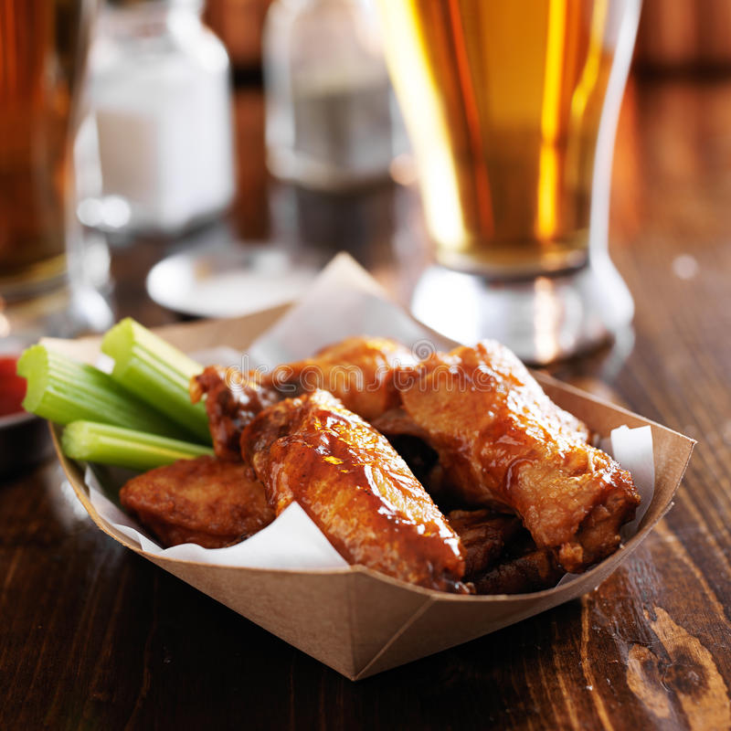 Buffalo chicken wings in basket. With celery and ranch royalty free stock photography