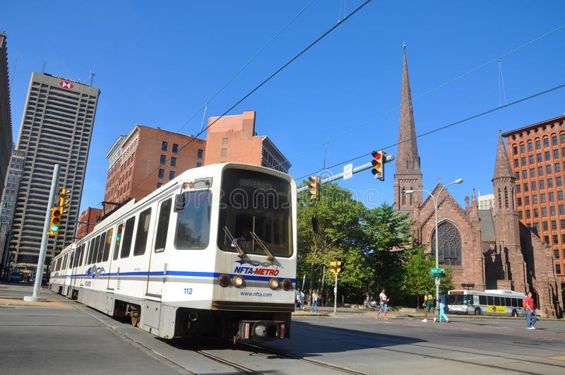 Buffalo Metro Rail, Buffalo, New York. Buffalo Metro Rail on Main Street at Church Street, with St. Paul`s Episcopal Cathedral in downtown Buffalo, New York, USA stock image