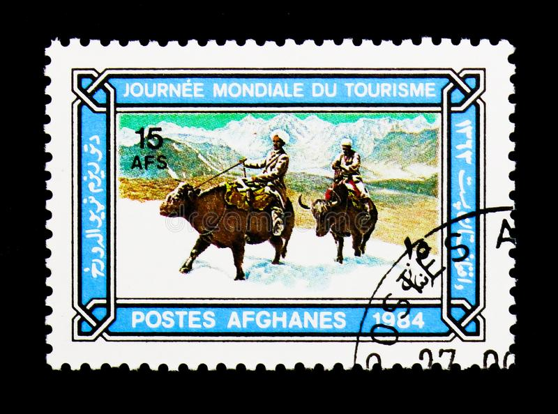 Buffalo riders in snow, World Tourism Day serie, circa 1984. MOSCOW, RUSSIA - DECEMBER 21, 2017: A stamp printed in Afghanistan shows Buffalo riders in snow royalty free stock image