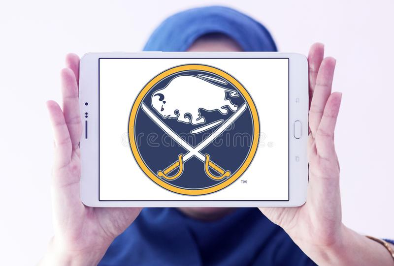 Buffalo Sabres ice hockey team logo. Logo of Buffalo Sabres ice hockey team on samsung tablet holded by arab muslim woman. The Buffalo Sabres are a professional stock image