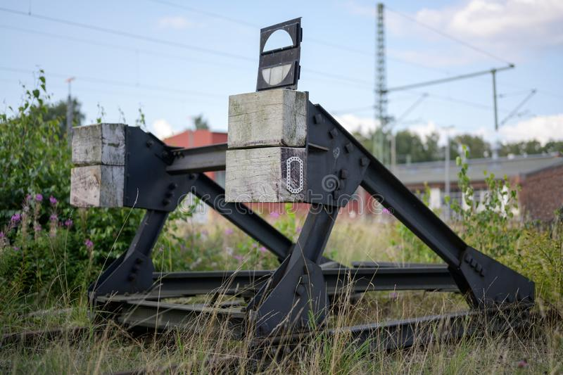 Buffer stop at the end of a disused railway track. Selected focus stock photo