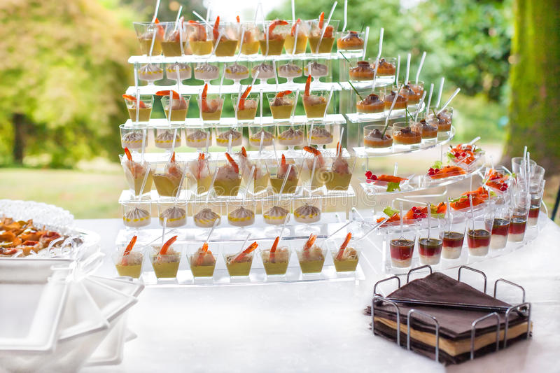 Buffet with appetizers or finger food stock photos