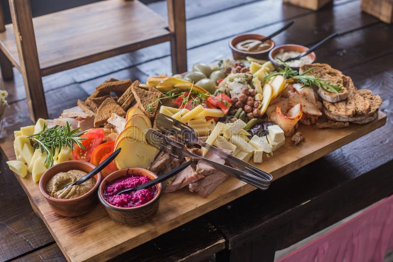 Buffet of assorted cheese cured meat, sausage, ham, fruit, vegetables, olives, pickled, bread and sauce for the event or royalty free stock photo