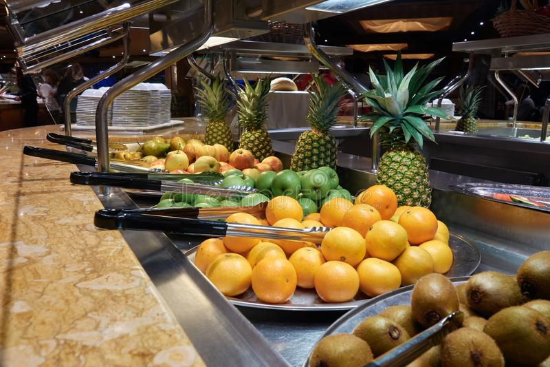 Buffet on the cruise ship. Fruit: kiwi, oranges, apples and pineapples stock photo