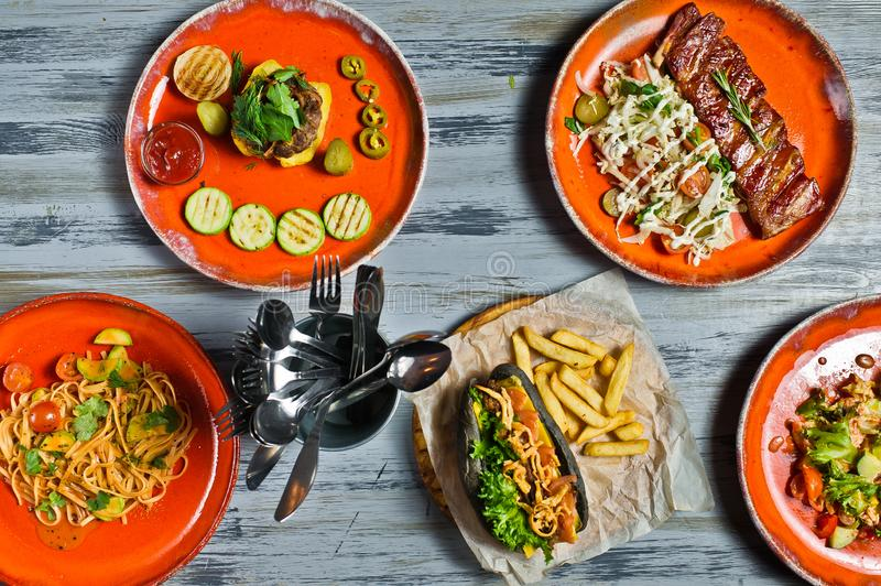Buffet Food Grill Meat Lunch Restaurant Menu Banquet Concept Hot dog, barbecue pork ribs, steak, Carbonara paste and crab salad. stock photography
