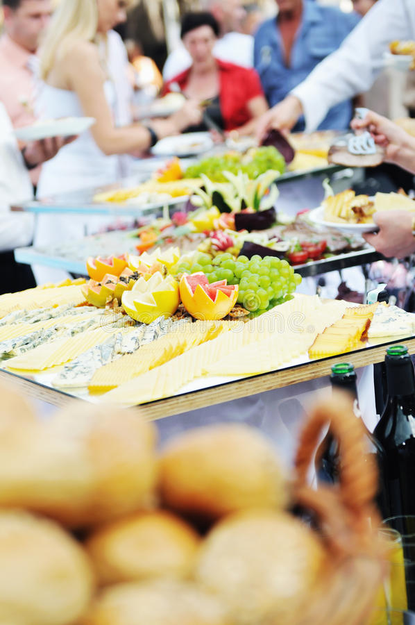 Buffet food people stock photography