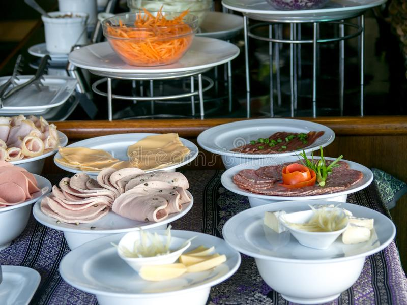 Buffet meal at a hotel,appetizer. Hotel breakfast board all you can eat buffet.  stock photography