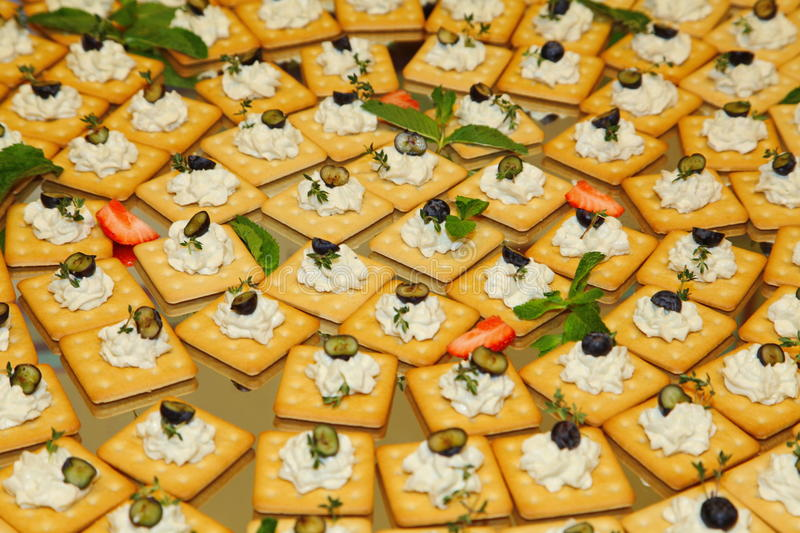 buffet snacks finger food biscuits crackers with soft curd cheese olives and herbs on a. Black Bedroom Furniture Sets. Home Design Ideas