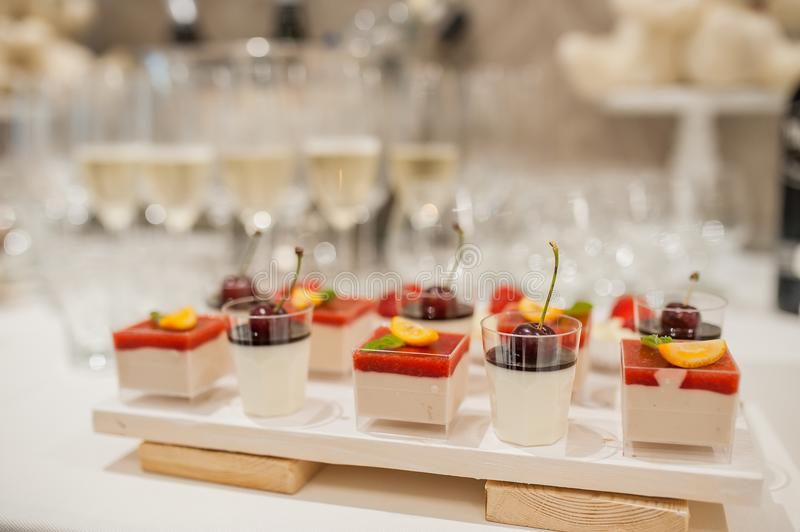 Buffet of sweets at the wedding table. Celebration stock photos
