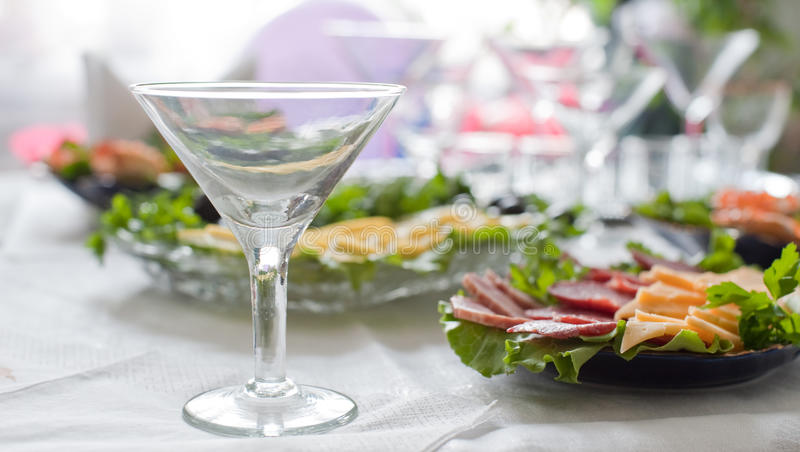 Buffet table. A table with glasses and easy snack stock photos