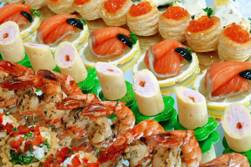 Buffet table. Laying of a celebratory buffet table stock photos