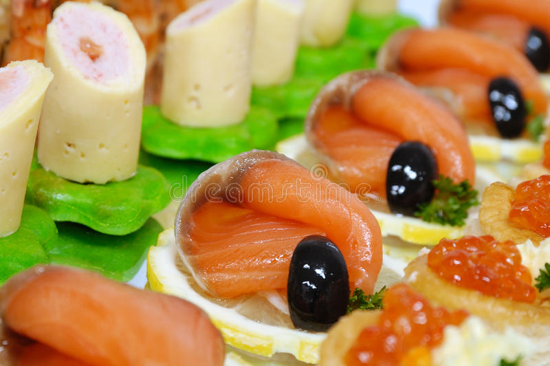 Buffet table. Laying of a celebratory buffet table royalty free stock photography