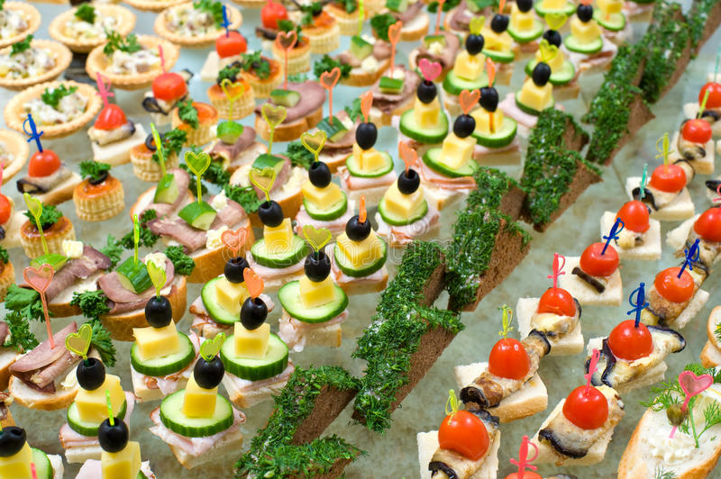 Buffet table. A lot of canapes with skewers and sandwiches on buffet table, shallow DOF royalty free stock photo