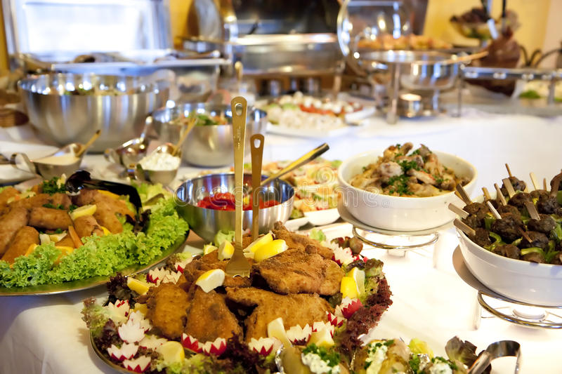 Buffet table. At a dinner party royalty free stock photos