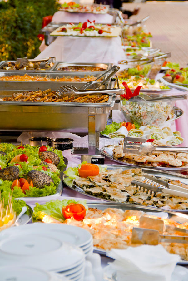 Buffet table. Full of food stock photos