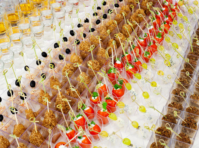 Buffet table. A lot of cold snacks and drinks on buffet table, catering royalty free stock images
