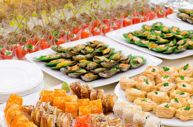 A buffet table. A lot of cold snacks on buffet table, catering stock photos