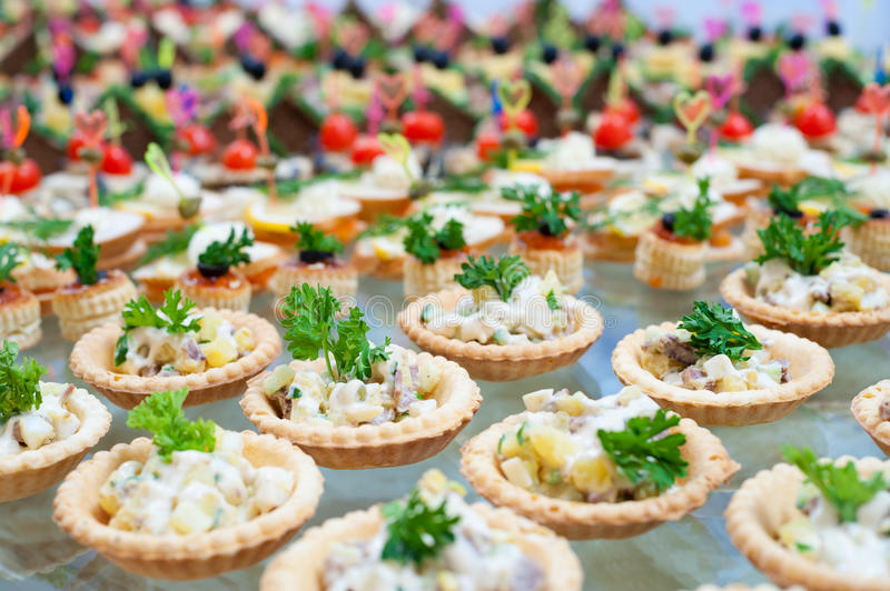 Buffet table. Many tartlets with meat salad on buffet table stock images