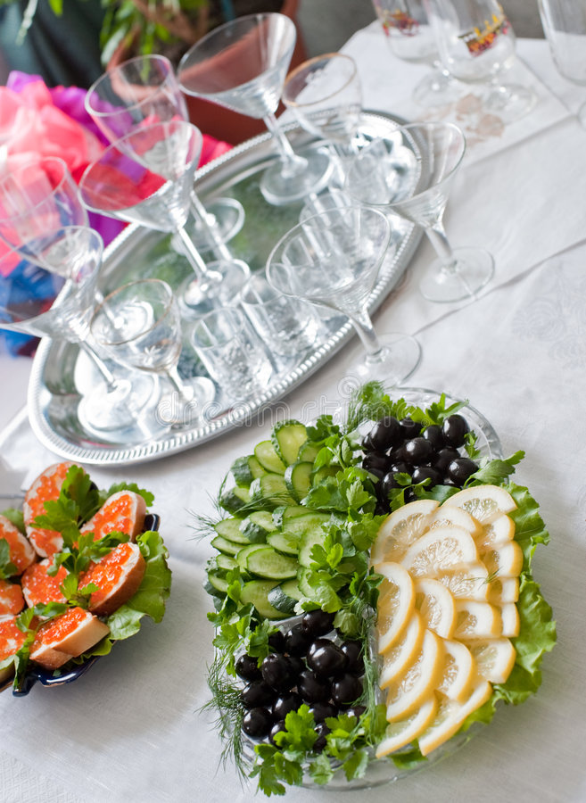 Buffet table. A table with glasses and easy snack stock photo