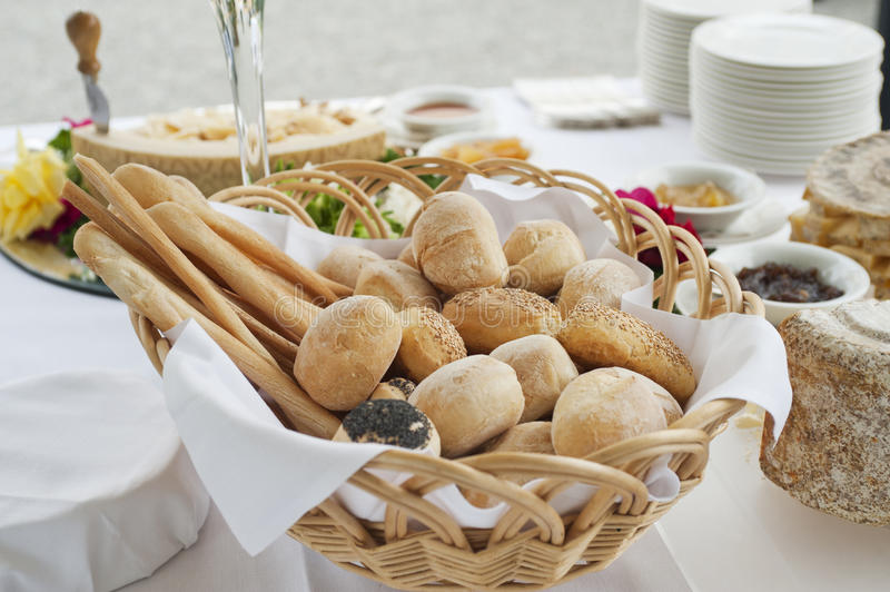 Buffet table. With basket of bread in foreground stock photos