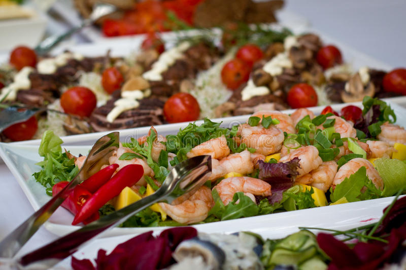 Buffet table. Delicious salads on buffet table royalty free stock image