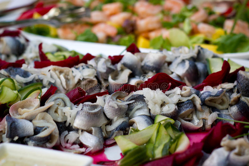 Buffet table. Delicious fish on buffet table royalty free stock photos