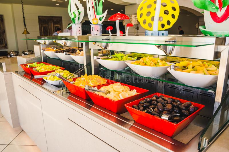Buffet table in the hotel. Different dishes in buffet table in the hotel dinning room royalty free stock photos