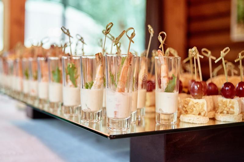 Buffet table with snacks, canape and appetizers at luxury wedding reception, copy space. Serving food at event. Catering banquet royalty free stock photo