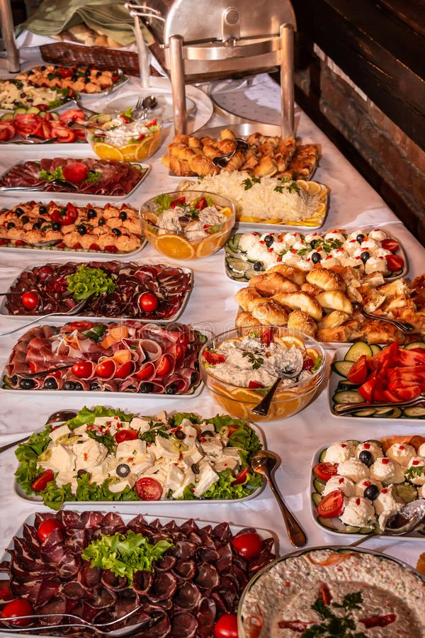 Buffet table with snacks. Buffet table with cold snacks and delicious appetizers. Catering food event banquet table royalty free stock image