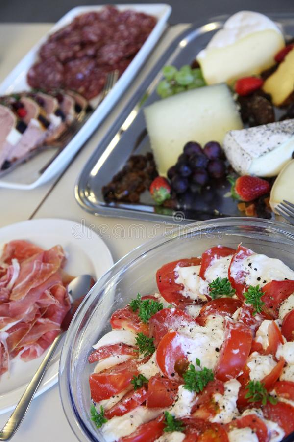 Buffet vegetables cheese meat stock image