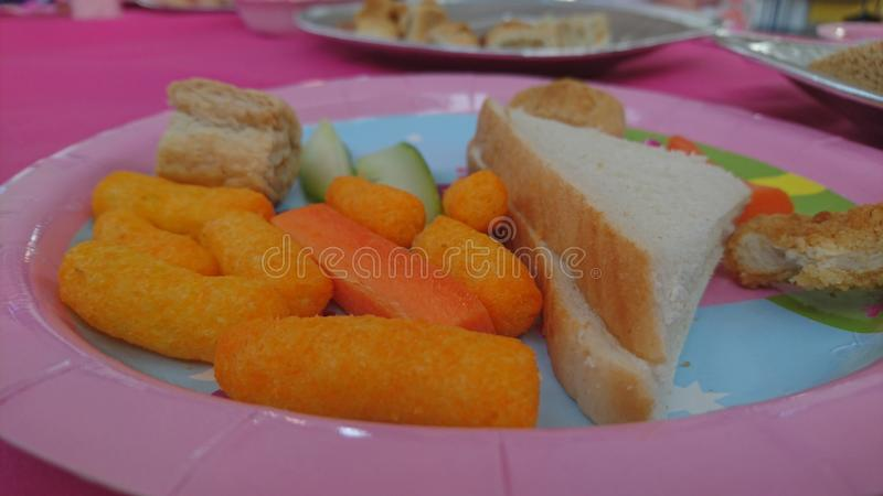 A close up of a plate of party food stock photos