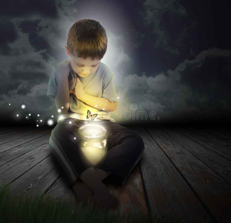 Free Bug Boy Child With Glowing Butterfly At Night Stock Images - 29006954
