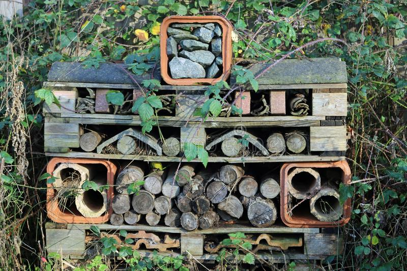 Bug hotel made from wooden pallets royalty free stock photos