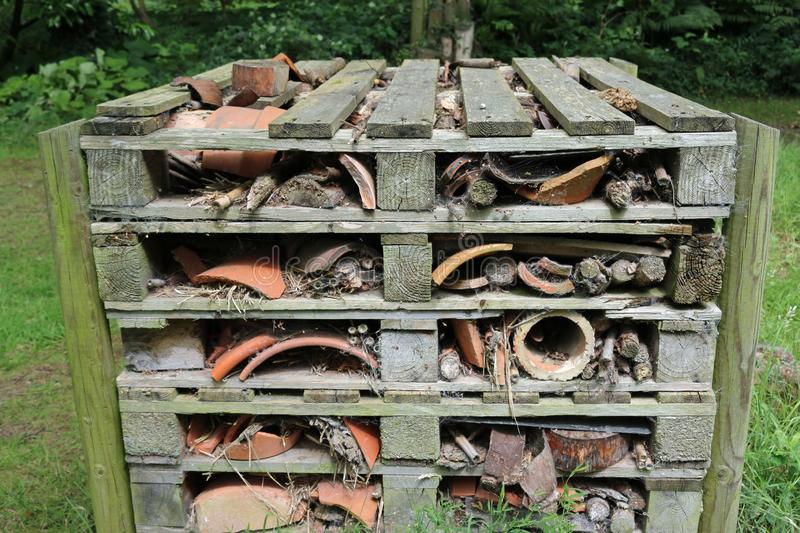 Bug hotel made from wooden pallets royalty free stock image