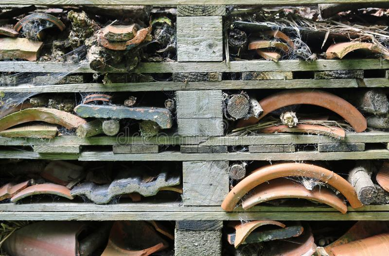 Bug hotel made from wooden pallets royalty free stock images