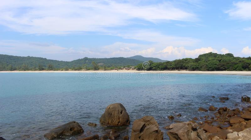 Bugalows on a pristine beach near Dawei Myanmar. A horseshoe-shapped bay with some rustic bungalows on the unspoiled Dawei peninsula in southern Myanmar. People stock images