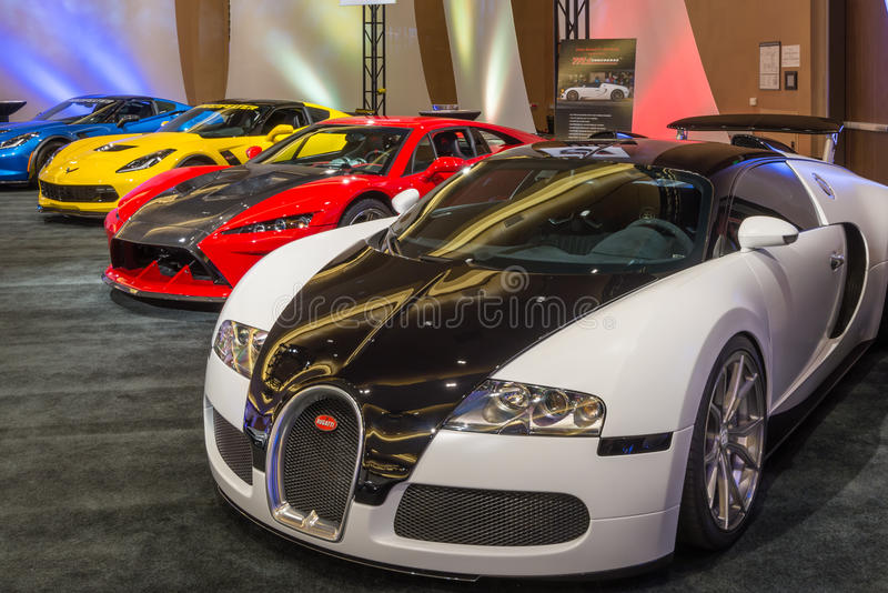 2016 Bugatti Veyron, Falcon F7, and Lingenfelter Z06 Corvette. DETROIT, MI/USA - JANUARY 10, 2016: Bugatti Veyron, Falcon F7, and Lingenfelter Z06 Corvette at stock photo